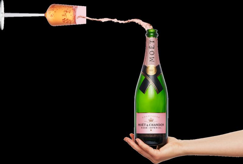 Hånd med champagne